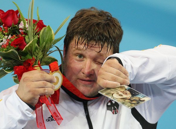 Joy and tears<br>This photo, which won Germany's Sports Photo of the Year award, captured one of the genuine Olympic heart-tuggers of Beijing 2008. There were few dry eyes in the house when weightlifter Matthias Steiner dedicated his gold medal to his wife Susann, who had been killed in a car accident the year before.Photo: DPA