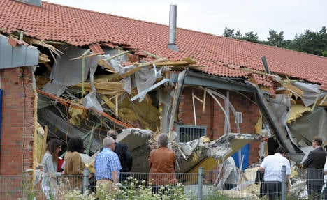 Supermarket thieves tear down wall, but leave cash