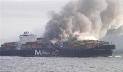 Burned cargo ship hunting for a port