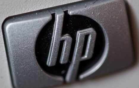Hewlett Packard execs face bribery charges