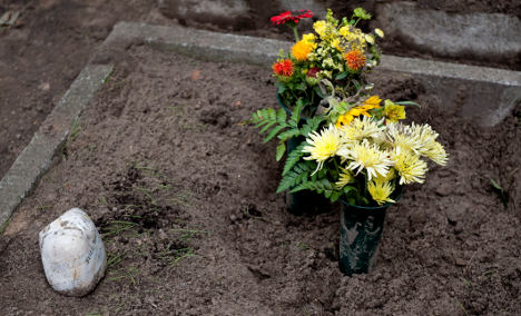 Graverobber 'blackmailed woman with son's ashes'