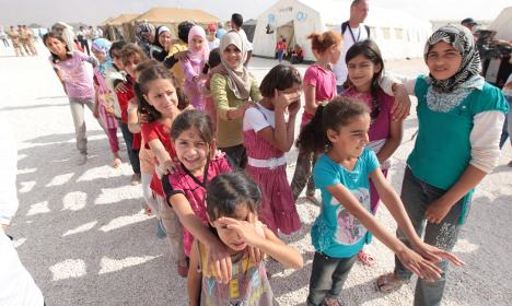 Germany will take Syrian refugees but not alone