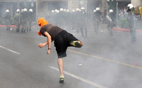 Fury in Athens as Merkel comes to town