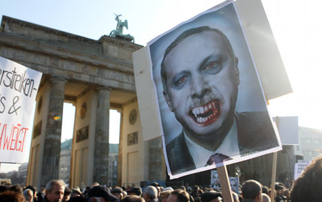 Protesters greet Turkish PM in Berlin