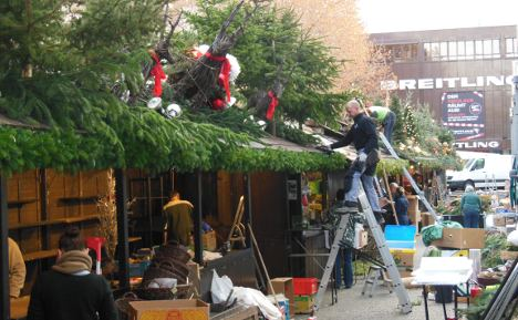 Behind the Christmas market holiday sparkle