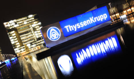 ThyssenKrupp halves pay after losses