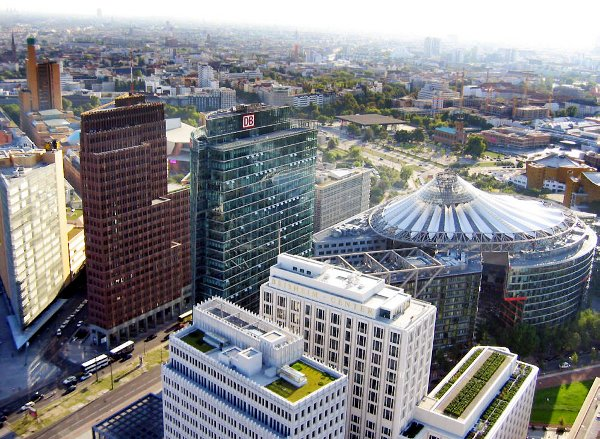 Potsdamer Platz<br>Now: After undergoing a profound redevelopment in the mid 90s, the area is now a shiny cluster of high-rise buildings with corporate offices, shopping and entertainment. Many Berliners criticize the lack of urban cohesiveness, but tourists don't seem to mind.  Photo: Wikipedia Commons