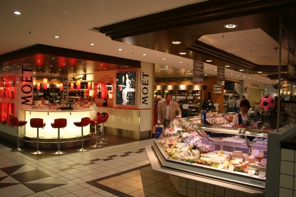 KaDeWe<br>Now: After extensive renovations in recent years, the store has managed to remain the united capital's shining temple to consumerism. Its top storey gourmet market would probably even still tantalized Bowie's pampered palate.Photo: Wikipedia Commons