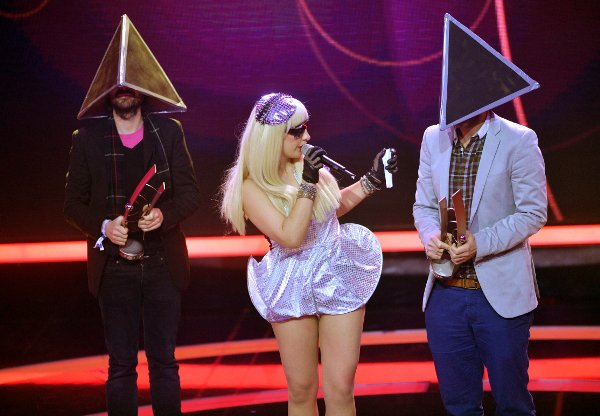 German band Deichkind are accompanied by a Lady Gaga Double to collect the Club/Dance/National International category award