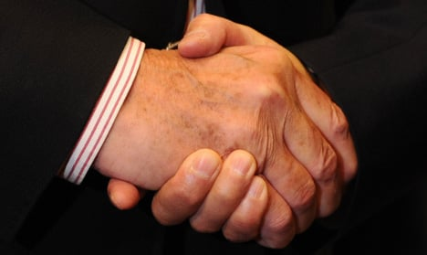 3. If in doubt, shake hands<br>As well as shaking hands in greeting, Germans also shake hands with everyone in a room before <i>and after</i> a business meeting or conference. If you have to leave early, shake everyone's hand again, starting with the most senior person present and working down. The German handshake is firm and brief, said to convey confidence and reliability. A weak handshake will suggest you are unsure of your abilities.Photo: DPA
