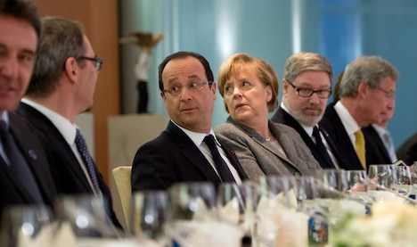 Germany and France talk growth, avoid Cyprus