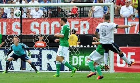 Dempsey scores two as USA down Germany