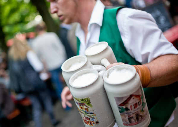 <b>Life at the bar:</b> Away from the Oktoberfest, life in a German restaurant, beer garden or bar can be more leisurely. Germans are also used to tipping well. Photo: DPA