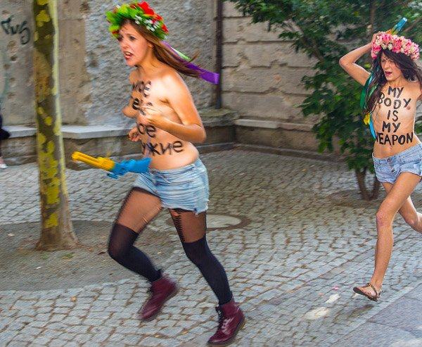 Topless feminists protest in Berlin at police raids