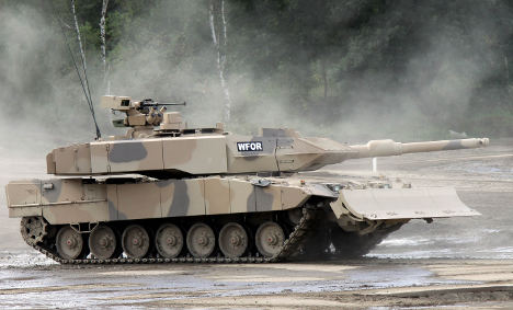 Merkel gets flak for record Gulf arms sales