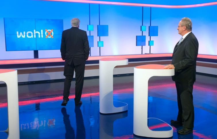 Bavarian leader Horst Seehofer (l) was given a rough ride on Wednesday night in a TV debate by SPD challenger and Munich mayor Christian Ude.Photo: DPA