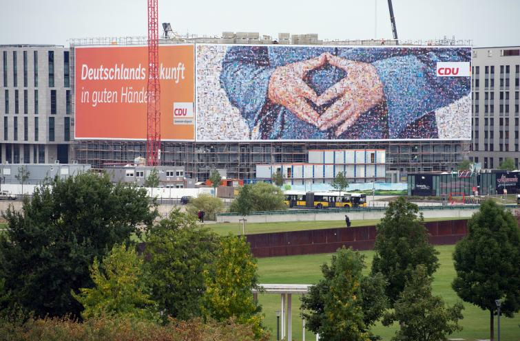 A huge picture of Angela Merkel's 'triangle of power' hands appears over Berlin.Photo: DPA