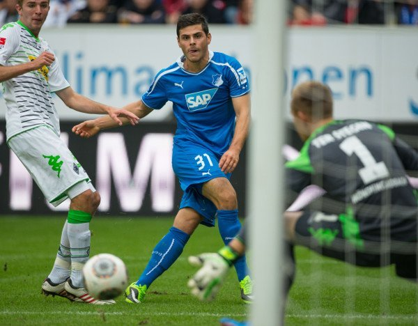 TSG Hoffenheim 2-1 Bor M'gladbach<br>Kevin Volland scores his second goal for Hoffenheim on Sunday, stroking the ball past Ter Stegen in the Gladbach goal.Photo: DPA
