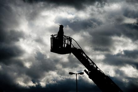 A fireman silhouetted againsta a stormy sky in Hannover, where strong winds caused parts of buildings to fall down.Photo: DPA