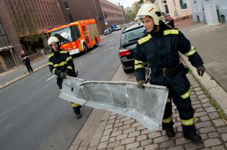 Firefighters in Hannover carry away metal building material which had fallen off a building during the storm.Photo: DPA