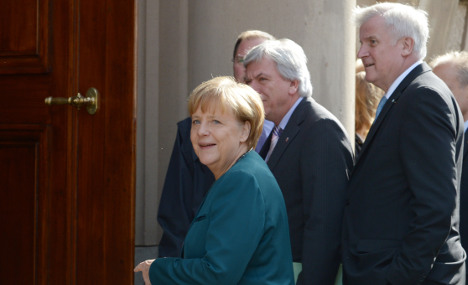 Merkel and left-wing rival end first round of talks