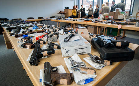 Police find mines, guns and grenades in home