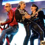 """Rudolf Schenker, Matthias Jabs and lead singer Klaus Meine performing their hymn for the fall of the Berlin Wall """"Wind of Change"""" in Hannover in 2006.Photo: DPA"""