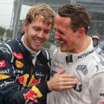 The 26-year-old celebrates with Michael Schumacher at the Grand Prix in Sao Paulo after winning his third World Championship in a row.Photo: DPA