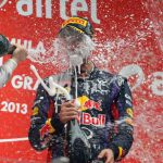 The young German is soaked in champagne after clinching this year's World Championship title in India.Photo: DPA