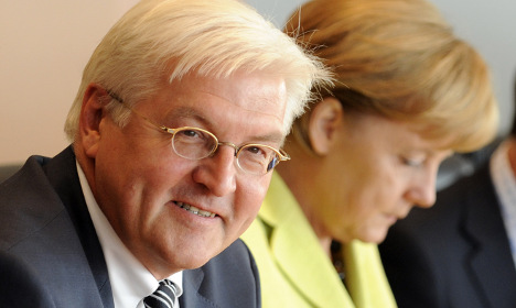 Merkel's ex-foreign minister returns to role