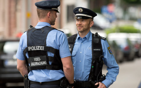 More cops to carry ID numbers - and cameras