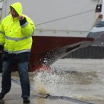 A ferry worker is almost blown over in Emden, Lower Saxony.Photo: Ingo Wagner/dpa