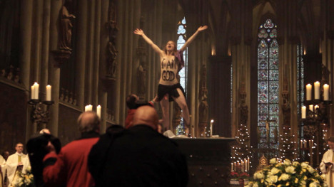 Topless protest spoils Christmas service