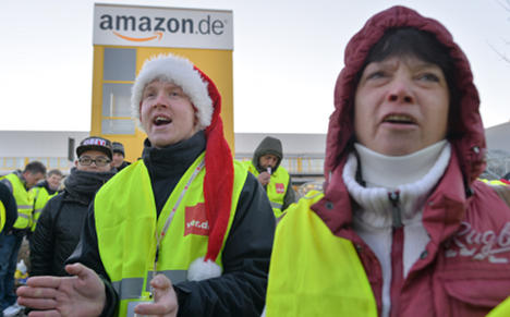 Amazon staff strike as pay battle rages
