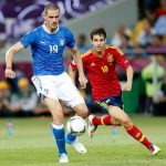 """9) """"Falsche Neun"""" (False number nine) is the football tactic - perfected by Spain – where the player in the number nine shirt, who would traditionally be a striker, starts in a midfield position and then moves up the field. Pictured is Spanish midfielder Cesc Fabregas vying for the ball with Italy's Leonardo Bonucci in the Euro 2012 final.Photo: DPA"""