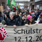 School children hold up a banner at the Hamburg protest, in which around 3,500 young people took part.Photo: DPA