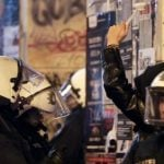"""A toilet brush has been held up as a symbol of Hamburg demonstrators, who on Wednesday night protested against a """"restricted zone"""" put in place by police.Photo: DPA"""