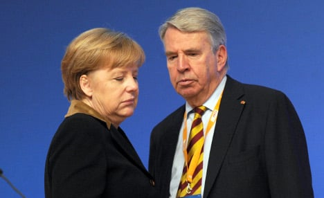 Merkel ally quits over tax scandal