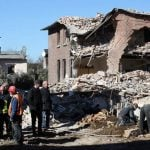 Onlookers survey the destruction after a house exploded in Itzehoe, Schleswig-Holstein, on Monday. Four people died. Photo: DPA