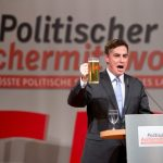 The CDU's candidate for European Commission president, David McAllister, took his glass on stage with him as he addressed the party's rally in Baden-Württemberg. Photo: DPA
