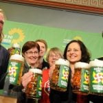 The Green Party share a beverage, their steins emblazoned with windmills and slogans supporting the Energiewende, a major  political project aimed at cutting out fossil fuels and nuclear power from Germany's energy supply.Photo: DPA