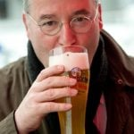 Gregor Gysi, chairman of the parliamentary fraction Die Linke, was also spotted enjoying a beverage at his party's Ash Wednesday rally in Passau, Bavaria.Photo: DPA
