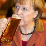 Even the esteemed chancellor gets in on the Ash Wednesday beer tradition, pictured here taking a swig at last year's CDU Aschermittwoch rally in Mecklenburg-Western Pomerania.Photo: DPA