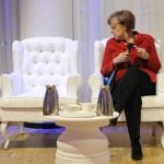 Angela Merkel awaits President Obama at the Nuclear Security Summit in The Hague on Tuesday.Photo: DPA