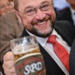 Social Democrat Martin Schulz has been president of the European Parliament since January 2012 and is now the party's candidate for the European Commission presidency. He poses with a beer at the SPD rally.Photo: DPA