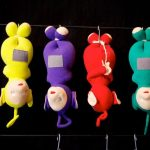 """Eyeless toys of the stars of UK children's show """"Teletubbies"""" hang by their feet like carcasses - from left to right they are La-La, Tinky-Winky, Po and Dipsy.Photo: Miroslav Menschenkind"""