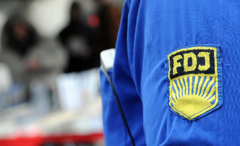 Men fined for wearing East German shirts