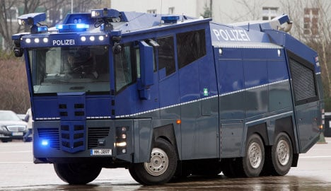 Police damage own water cannon with eggs