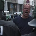 """A counter-demonstrator screams """"Nazis out!"""" as the march continues.Photo: J. Arthur White"""