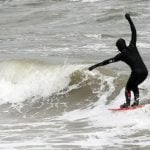 Stormy weather on the Baltic Sea on Friday made great waves for surfers.Photo: DPA